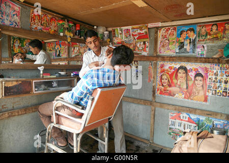 The barber shop in the street of Pushkar, India. - Stock Photo