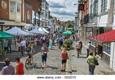 Guildford historic High Street and shoppers on a busy summer farmers market day Guildford Surrey UK - Stock Photo