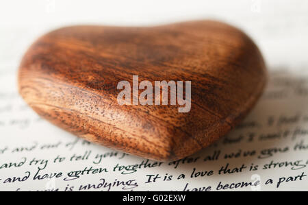 A wooden heart on a love letter - Stock Photo