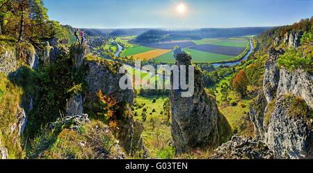Traveller on a rock, Altmuehl valley, mountain Arn - Stock Photo