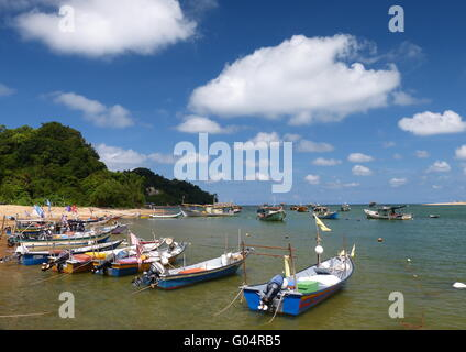 Motor speedboats berthed in a fishing village in the east coast of Malaysia under clear blue skies. - Stock Photo
