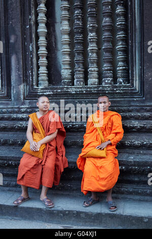 Buddhist monks at Angkor Wat (12th century Khmer temple), Angkor World Heritage Site, Siem Reap, Cambodia - Stock Photo