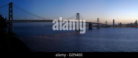 Bay Bridge in the gathering dusk. A high-resolution stitched image shot from Treasure Island - Stock Photo