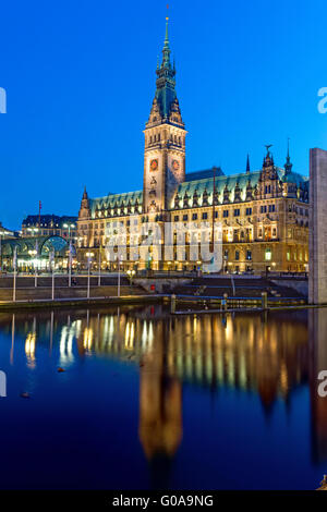 The townhall of Hamburg in Germany illuminated at - Stock Photo