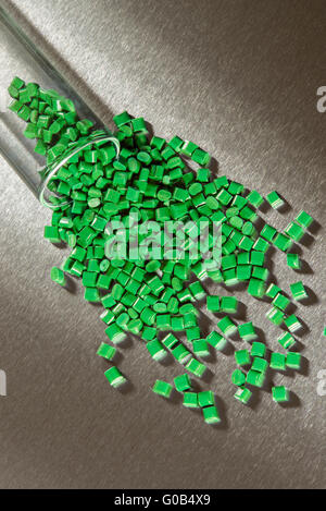 green polymer granulate stainless stainless steel - Stock Photo