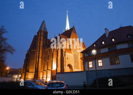 Church of the Holy Cross and St Bartholomew at night in Wroclaw, Poland - Stock Photo
