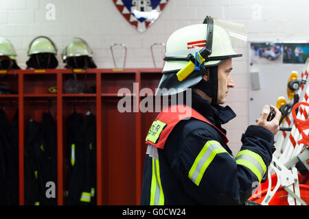 Firefighter in the fire department with radio. - Stock Photo