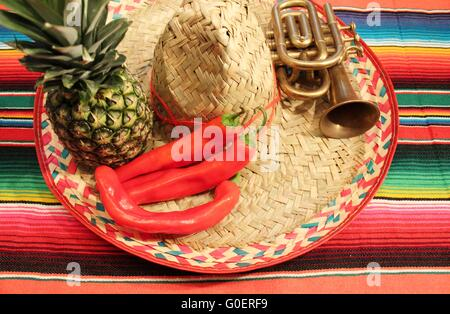 Mexican fiesta poncho rug  in bright colors with s - Stock Photo
