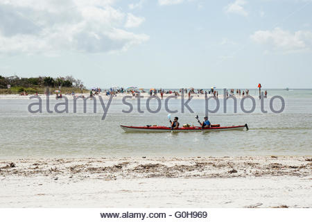 Kayakers cruise Wiggins Pass in Florida, between Barefoot Beach Preserve and Delnor-Wiggins Pass State Park - Stock Photo