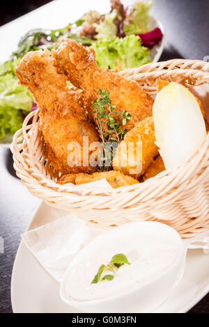 Crisp crunchy golden chicken legs and wings - Stock Photo