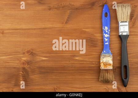 Paint brush on wooden background. Sales of paints and brushes. Housework. Supplies for painters. - Stock Photo