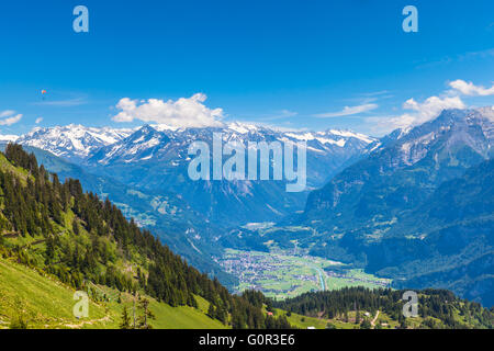 Panorama view on the hiking path on Bernese Oberland with mountain range of the alps, Switzerland. - Stock Photo