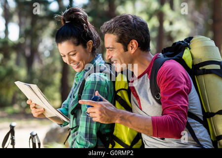 couple hiker studying map and compass - Stock Photo