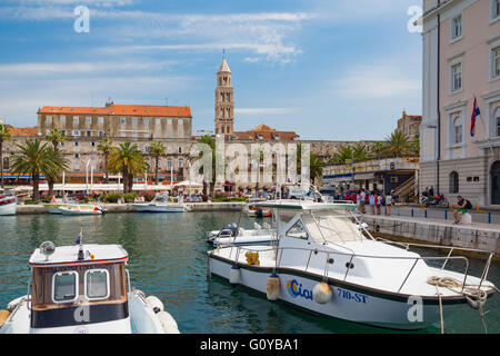 Split, Dalmatian Coast, Croatia.  The harbour.  The tower in the background is the bell tower of Saint Domnius cathedral. - Stock Photo