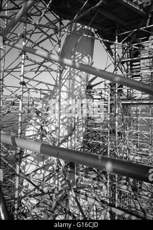Entitled: 'Torch-bearing arm and profile seen through scaffolding, March, 1985.' The Statue of Liberty is a colossal - Stock Photo