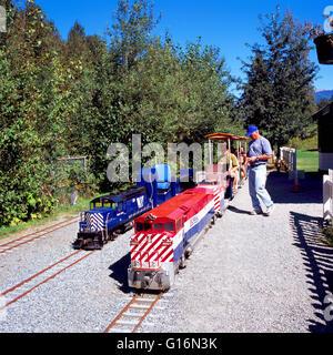 Miniature Train and Locomotive Engine at West Coast Railway Heritage Park, Squamish, BC, British Columbia, Canada - Stock Photo