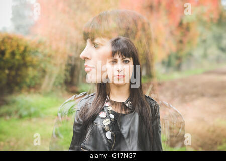 Double image of young woman outdoors - Stock Photo