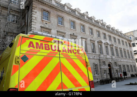 Ambulance vehicle parked outside St Barts Hospital building in Central London UK  KATHY DEWITT - Stock Photo