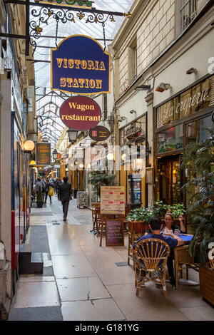 Shops and Cafes in Passage des Panoramas, Paris, France - Stock Photo