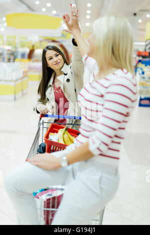 Women satisfied after shopping in supermarket - Stock Photo