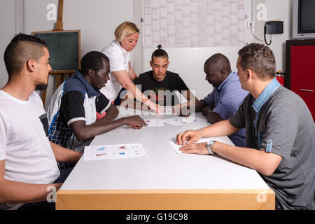 Language training for refugees in a German camp - Stock Photo