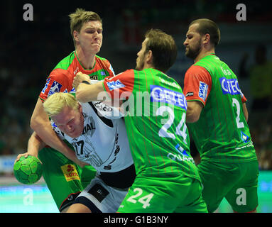 Kiel's Patrick Wiencek (C) and Magdeburg's Finn Lemke (l-r), Michael Haass and Zeljko Musa in action during the - Stock Photo