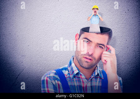 Composite image of attractive architect shouting at camera - Stock Photo