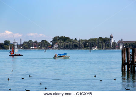 Isle of Frauenchiemsee with sailboats in Bavaria, Germany - Stock Photo