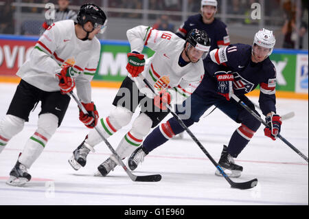 St. Petersburg, Russia. 13th May, 2016. Brock Nelson of the U.S. (R) vies with Daniel Koger (C) and Bence Sziranyi - Stock Photo