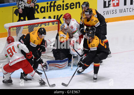 St. Petersburg, Russia. 13th May, 2016. Artur Gavrus of Belarus (1st L) attacks during an IIHF Ice Hockey World - Stock Photo