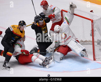 St. Petersburg, Russia. 13th May, 2016. Philip Gogulla of Germany (1st L) attacks during an IIHF Ice Hockey World - Stock Photo