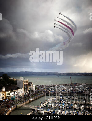 GB - DEVON: Red Arrows Royal Airforce Aerobatic Team above Torbay (Torquay Harbour in foreground) - Stock Photo