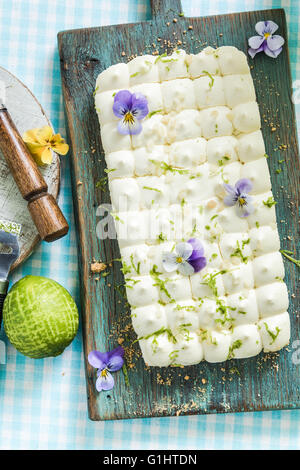 taste of summer, key lime pie and flowers - Stock Photo