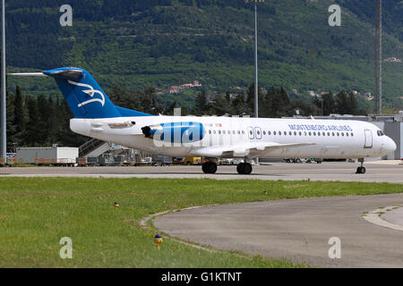 Montenegro Airlines Fokker 100 parked up at Tivat airport. - Stock Photo