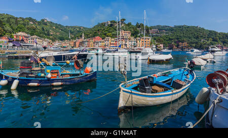 Portofino, Genoa Province, Liguria, Italian Riviera, Italy.  Boats in the harbour with the village behind. - Stock Photo