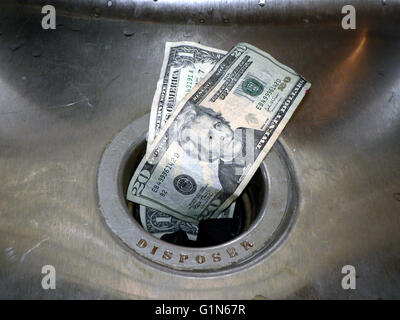 concept photo of money going down the rain - Stock Photo