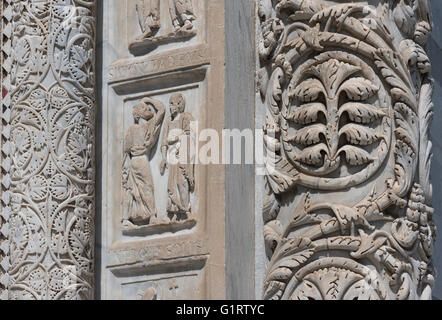 Marble columns at the main portal with floral motifs and scenes from the life of John the Baptist, Baptistery of - Stock Photo