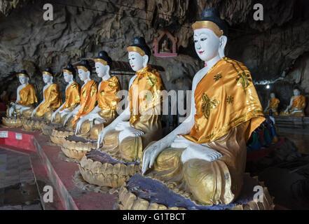 Buddha statues, Bayint Nyi (Bayin Gyi Gu or Begyinni) cave temple and hot springs, Mon State, Burma (Myanmar) - Stock Photo