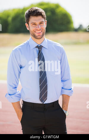 Portrait of businessman standing with hands in pocket - Stock Photo