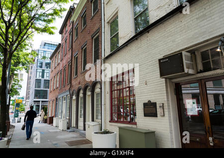 Street view of landmarked early 19th Century brick houses on Canal Street in New York City - Stock Photo