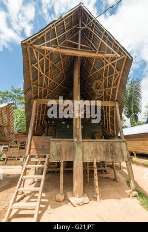 Outstanding and unique local architecture, wooden buildings with boat shaped rooftop and traditional decoration, - Stock Photo