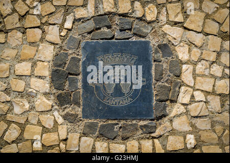 Santana district emblem on the stone pavement. Madeira island - Stock Photo