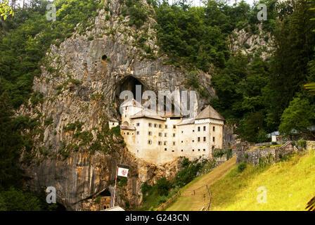 Predjama Castle, a Renaissance castle built within a cave mouth in south-central Slovenia - Stock Photo