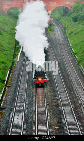 1940s British Rail Poster type image of The Flying Scotsman steaming up the Reading straits  towards Twyford, Thames - Stock Photo