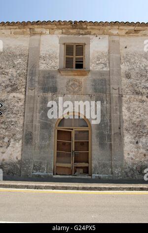 a beautiful frontal view of an old derelict door/ entrance/ house of a quiet village of Palma de Mallorca, Palma - Stock Photo