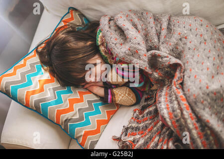 Sleeping Girl Curled Up On A Bed Stock Photo 89444870 Alamy