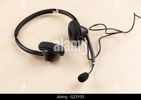 Office desk with headset. Call center support table - Stock Photo
