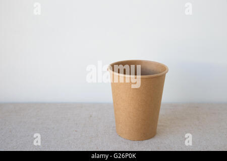 brown coffee paper cups, blank eco background - Stock Photo