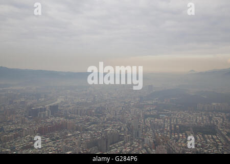 Smog over Taipei as seen from Taipei 101 tower in Taiwan. - Stock Photo
