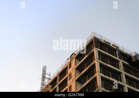 Concrete shell of a building being refurbished, re-purposed, recycled and rebuilt - Stock Photo